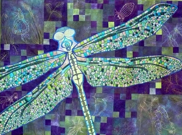 A dragonfly with wings like intricate mosaics. The whole picture, including background, is many shades of blue