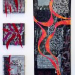 Textile artwork, freeform curved lines in red across background of grey and black squares and rectangles.
