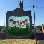 Realistic mock-up of a mural of floers on the end wall of a terrace of houses